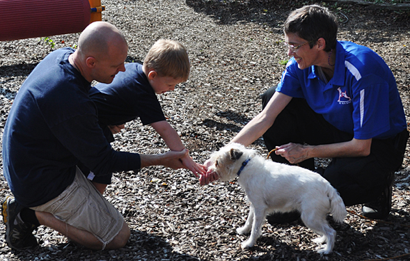 k 9 rescue unit dog with autistic child and parent